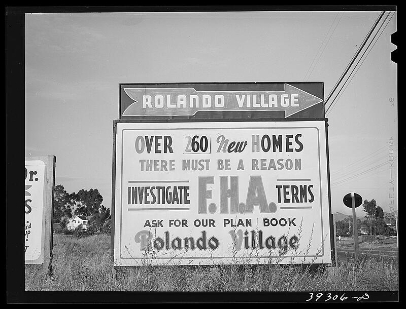 Photograph of a sign advertising loans from the Federal Housing Administration (FHA)