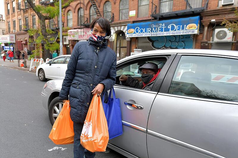 Client after receiving food from Food Bank For New York City