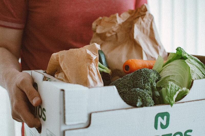 Man carrying a box of produce